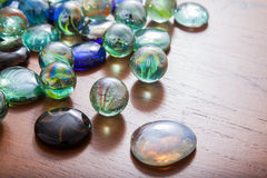Glass marble balls and glass pebbles Royalty Free Stock Photography