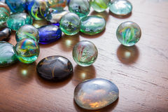 Glass marble balls and glass pebbles Royalty Free Stock Photos