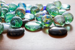 Glass marble balls and glass pebbles Stock Image