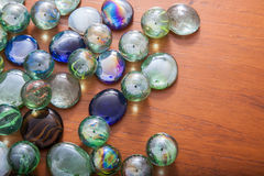 Glass marble balls and glass pebbles Stock Images