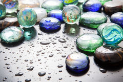 Glass marble balls and glass pebbles Stock Photo