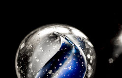 Glass marble. Blue color inside macro Royalty Free Stock Photo