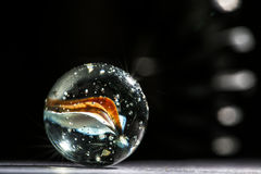 Glass marble macro a. Glass marble close up macro Royalty Free Stock Photo
