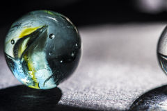 Glass marble macro a Stock Photography