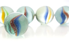 Glass marbles. Traditional glass marbles against a white background Stock Photography