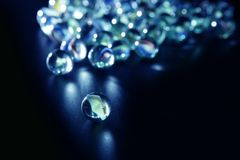 Glass marbles with blue reflections Stock Images
