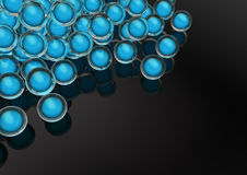 Glass marbles with glowing blue orb inside Stock Photography