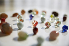 Glass marbles, rain flower stones, Cobbles Royalty Free Stock Photos