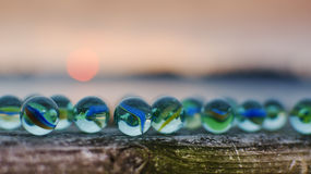 Glass marbles at sunset Royalty Free Stock Image