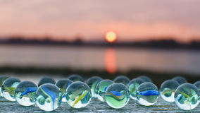 Glass marbles at sunset Royalty Free Stock Images