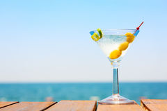 Glass of martini bianco at the wooden pier. Concept of summer va. Cation. Popular cocktail by the sea. Vacation background. Horizontal Royalty Free Stock Image