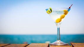 Glass of martini bianco at the wooden pier. Concept of summer va. Cation. Popular cocktail by the sea. Vacation background. Horizontal, wide screen format Stock Images