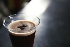 Glass of martini espresso cocktail in bar, closeup. Space for text stock image