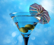 Glass with martini and green olives Royalty Free Stock Image
