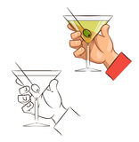 Glass of martini with olive in hand Stock Photography