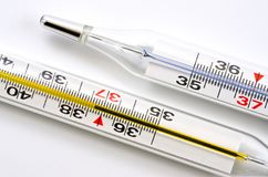 Glass medical thermometer thermometer for measuring body temperature shot on a white background.  royalty free stock photo