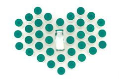 Glass medicine bottles heart shaped on white background royalty free stock images