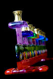 Glass menorah on black Stock Photography