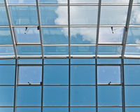 Glass and metal ceiling. Photo of business center glass ceiling with window motors stock images