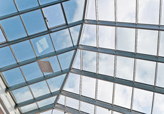 Glass and metal ceiling. Photo of business center glass ceiling with window motor and heater stock photos