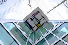 Glass and metal high rise building with colourful roof detail Stock Image