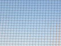 Glass with  metal mesh Royalty Free Stock Photo