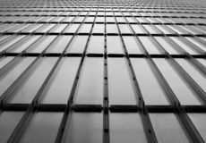 Glass and metal wall  with diagonal lines and  perspective background. black and white. Glass and metal wall with diagonal lines and perspective background royalty free stock image