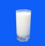 Glass of milk. On a blue background Stock Photography