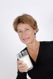 A glass of milk. Senior woman with a glass of milk Royalty Free Stock Photos
