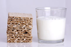 Glass of milk. A glass of milk and a slice of crunchy bread for diet Royalty Free Stock Photos
