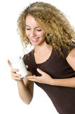 Glass of milk. A beautiful young women holding a glass of milk Royalty Free Stock Photos