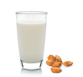 Glass of milk and almond  on white background Royalty Free Stock Images