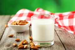 Glass of milk with almonds on the grey wooden background Stock Photos