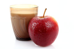 Glass with milk and apple isolated Stock Images