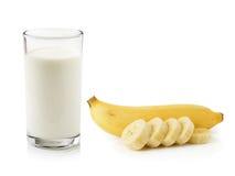 Glass of milk with banana Stock Photos