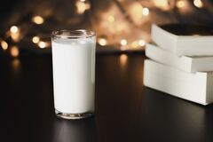 A glass of milk and books