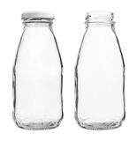 Glass Milk Bottles with/without Cap isolated on white background Royalty Free Stock Photos