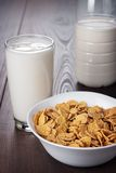 Glass of milk and bowl of cornflakes Stock Images