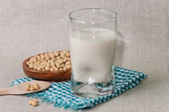 Glass of milk and bowl with soy Stock Photography