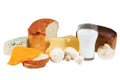 Glass of milk, bread, mushrooms and cheese Stock Images