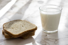 Glass of milk and bread Royalty Free Stock Images