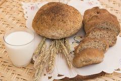 Glass of milk and bread. Bread, glass of milk and rye Stock Photos