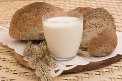Glass of milk and bread. Bread, glass of milk and rye Stock Images