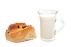Glass of milk and a bun Stock Image