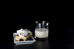 Glass milk and cake with blackberries Stock Images