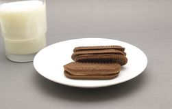 Glass of milk with chocolate biscuits Stock Image