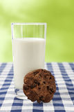 Glass of milk and chocolate chip cookie Royalty Free Stock Image