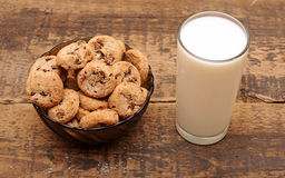 Glass of milk and chocolate chip cookies Stock Photos
