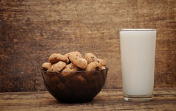 Glass of milk and chocolate chip cookies Stock Images