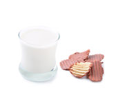 Glass of milk and  chocolate coated potato chips Royalty Free Stock Photos